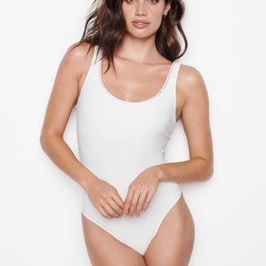 New BODY BY VICTORIA White Plunge Bodysuit teddy